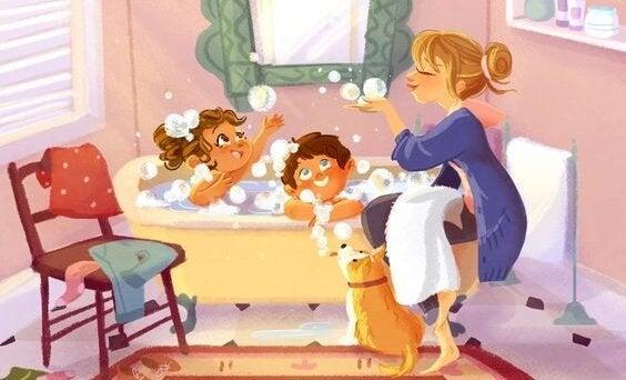 泡風呂にいるお母さんと子どもたち