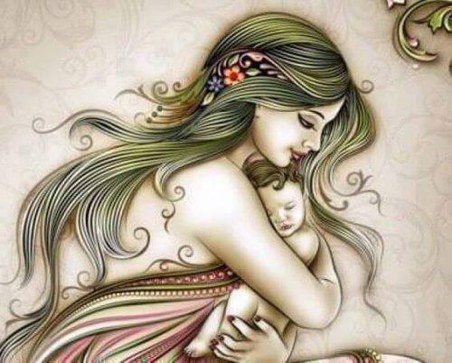 赤ちゃんを抱き締める母親